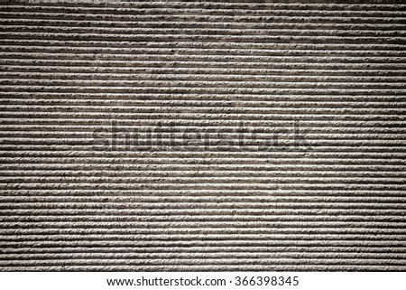 Gray lined plaster street wall texture - stock photo