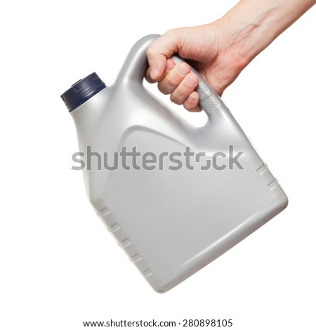 gray machine oil canister in hand isolated on a white background - stock photo