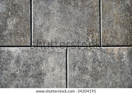 Gray marble wall, brickwork, horizontal rows brick - stock photo