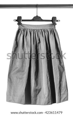 Gray maxi skirt on clothes rack isolated over white