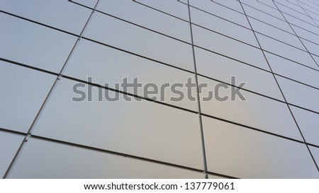 Gray metal perspective wall of business center with abstract lines