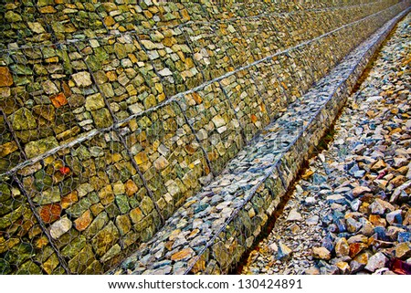 gray mosaic prospect wall , yellow background - stock photo