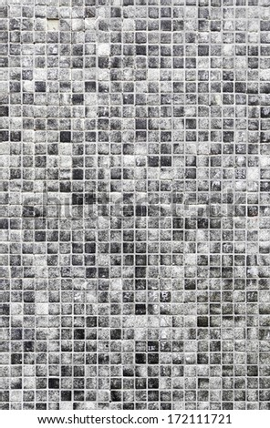 Gray mosaic tile detail of a wall decorated with tiles, interior decoration - stock photo