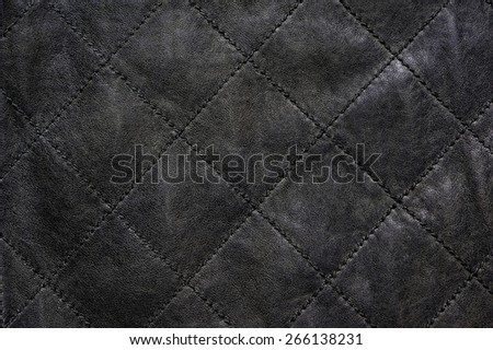 Gray natural leather stitched diagonally - stock photo