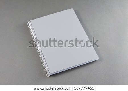 Gray notebook on a gray background - stock photo