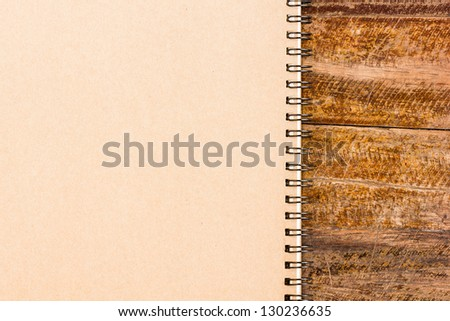 Gray notebook on wooden table