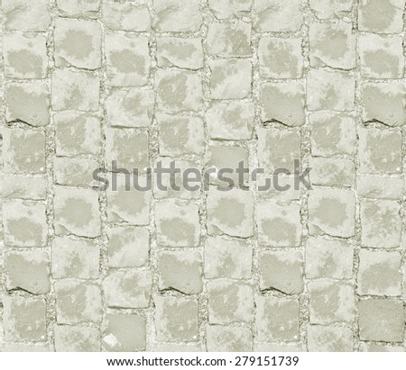 Gray Old Paving Stone Closeup. Seamless Tileable Texture. Grey Stone Block Seamless Texture. Small cobblestone sidewalk made of cubic stones - stock photo