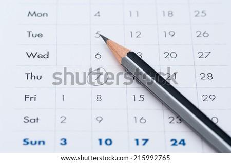 gray pencil on a open calendar business agenda - stock photo