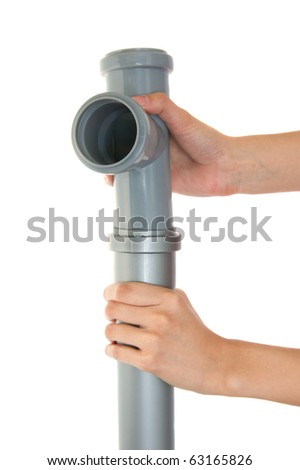 Gray plastic pipes isolated on the white - stock photo