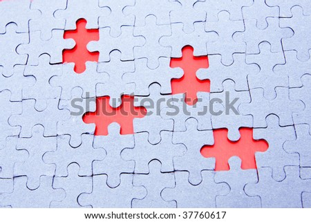 gray puzzle on red background - stock photo