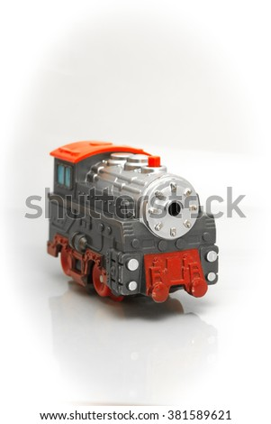 Gray-red toy train that travels quickly and beautifully played