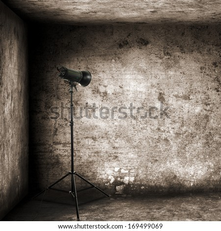 gray room and one lamp  - stock photo