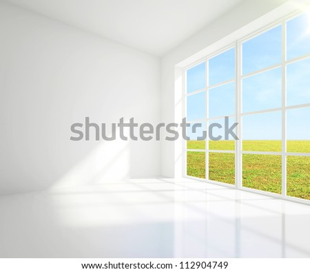 gray room with a view of field from window - stock photo