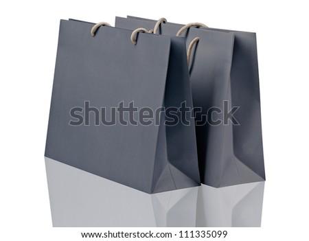 Gray shopping bags on white. - stock photo