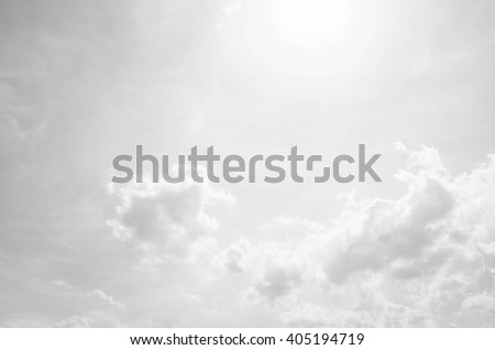 Gray sky sunlight fluffy clouds silver tone color  - stock photo