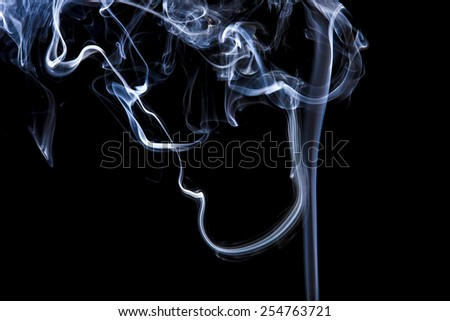 Gray smoke with light on back background