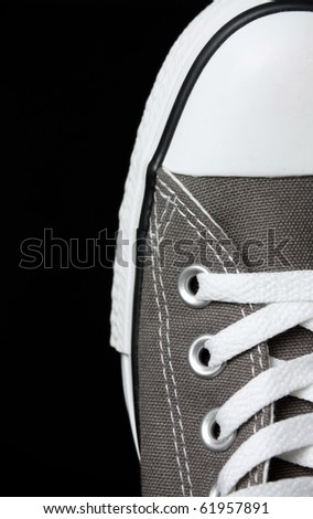 gray sneakers classic youth footwear at black background - stock photo