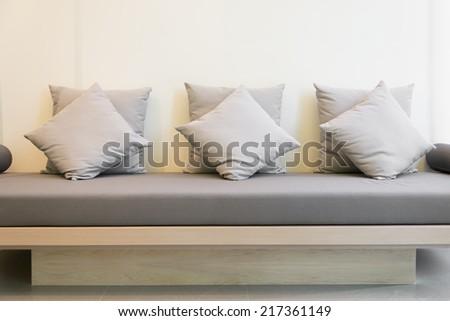 Gray sofa and cushions - stock photo