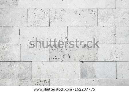 Gray stone wall closeup background photo texture - stock photo