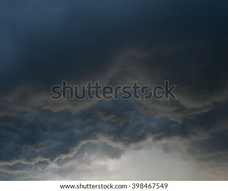 gray storm clouds at sunset - stock photo