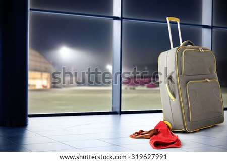 gray suitcase on floor and red towel  - stock photo