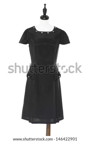 Gray sundress in female clothes on a dummy isolated on a white background - stock photo