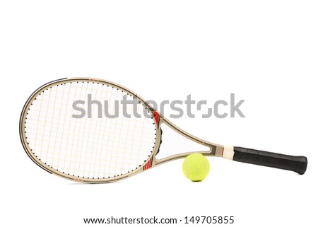Gray tennis racket and yellow ball - stock photo