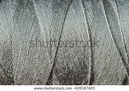 gray thread as a background - stock photo