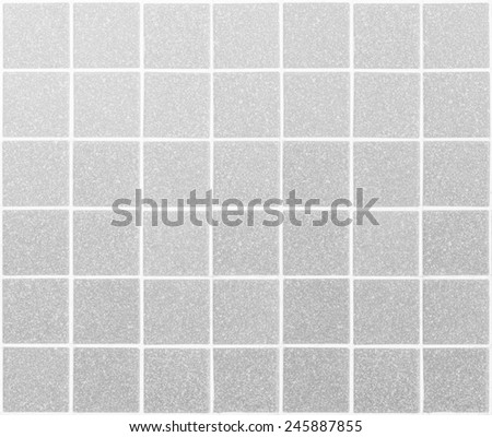 Gray tiles texture background. - stock photo