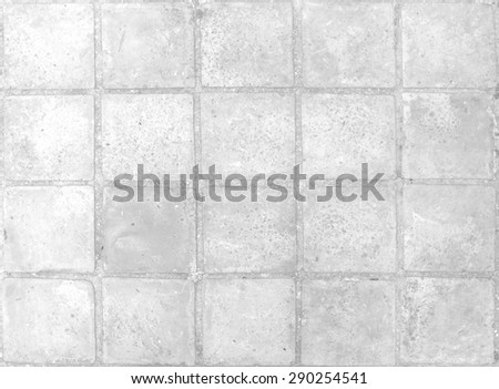 Gray tiles wall texture background. - stock photo