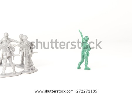 Gray toy soldiers excluding the green toy soldier - stock photo