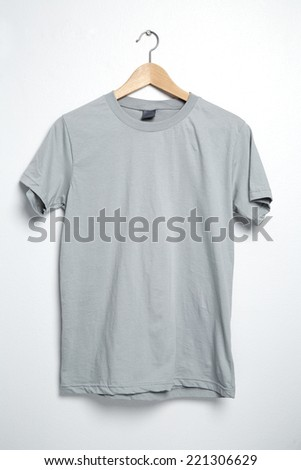 Gray tshirt template on hanger ready for your own graphics. - stock photo