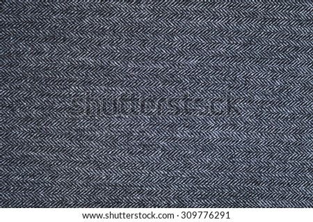 Gray tweed textile pattern. Textures and backgrounds