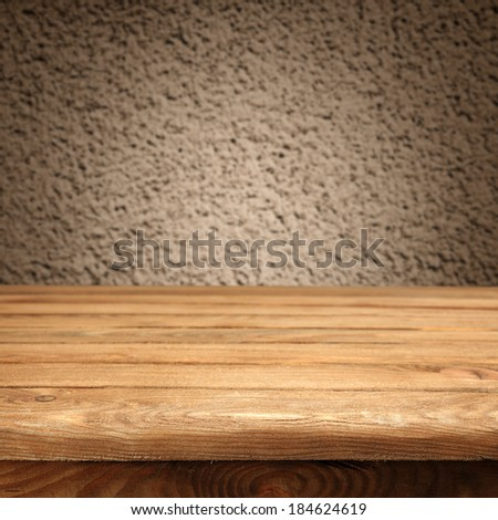 gray wall and desk of yellow  - stock photo