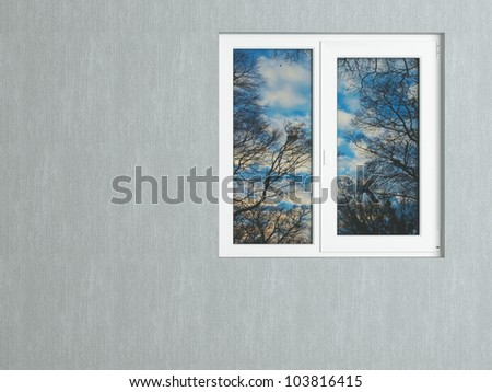 Gray wall and white window reflecting the nature. House exterior.