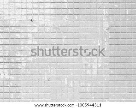 Gray white mosaic wall background in damaged grunge style