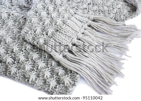 Gray winter scarf on white background. - stock photo