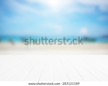 Gray wood floor with abstract blurred on vacation summer ocean background. Timber pattern texture stage. Blur nature green view outdoor. Focus to wooden in the foreground. Beautiful white sea beach. - stock photo