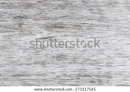 Gray wooden background of weathered distressed unpainted rustic wood showing woodgrain texture - stock photo