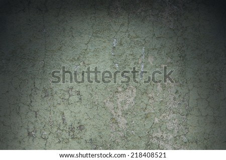 Grayish green weathered and distressed textured background wall, lit from above - stock photo