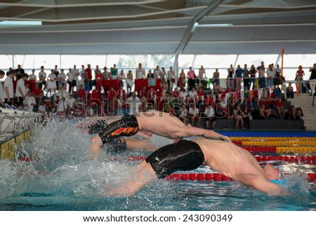 GRAZ, AUSTRIA - APRIL 04, 2014: Robert Zbogar (Slovenia) places 6th in the men's 50m backstroke event in an indoor swimming meeting. - stock photo