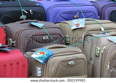 GRAZ, AUSTRIA: CIRCA JULY 2015: suitcases and bags for sale at a local market - stock photo