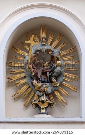 GRAZ, AUSTRIA - JANUARY 10, 2015: Coronation of the Virgin Mary painting on the house facade in Graz, Styria, Austria on January 10, 2015. - stock photo