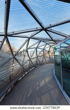 Graz, Austria - January 16, 2011: Island on Mur river connected by a modern steel and glass bridge, Styria, Graz, Austria - stock photo