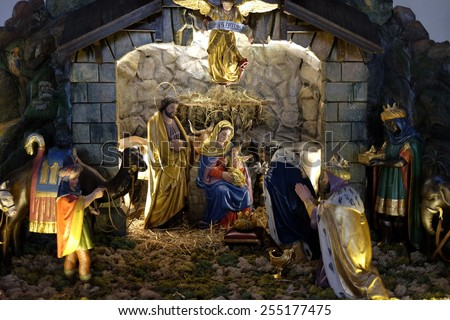 GRAZ, AUSTRIA - JANUARY 10, 2015: Nativity scene, creche, or crib, birth of Jesus in Parish Church of the Holy Blood in Graz, Styria, Austria on January 10, 2015. - stock photo
