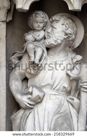 GRAZ, AUSTRIA - JANUARY 10, 2015: Saint Christopher on the portal of Parish Church of the Holy Blood in Graz, Styria, Austria on January 10, 2015.