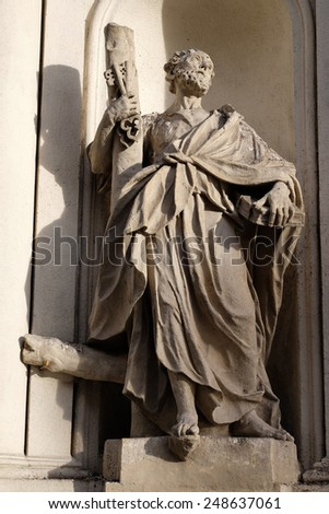 GRAZ, AUSTRIA - JANUARY 10, 2015: Saint Peter the Apostle on the facade of Parish Church of the Holy Blood in Graz, Styria, Austria on January 10, 2015. - stock photo