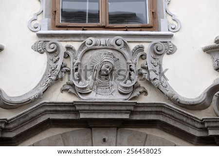 GRAZ, AUSTRIA - JANUARY 10, 2015: Virgin Mary, statue on the house facade in Graz, Styria, Austria on January 10, 2015. - stock photo