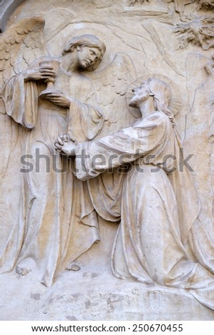 GRAZ, AUSTRIA - JANUARY 10, 2015: War Memorial, bas relief on Graz Cathedral dedicated to Saint Giles in Graz, Styria, Austria on January 10, 2015. - stock photo