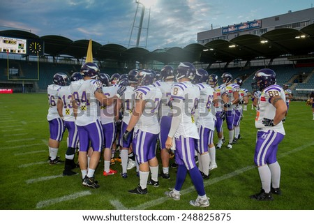 GRAZ, AUSTRIA - JUNE 29 The team of the Vienna Vikings in the huddle before the playoff game of the AFL on June 29, 2013 in Graz, Austria. - stock photo